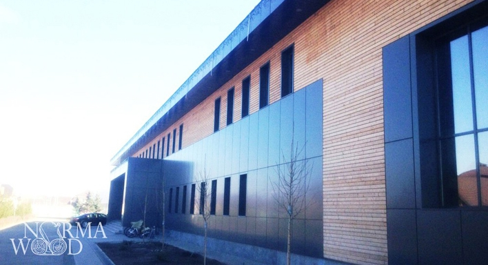 "Front of thermospruce and composite panels. Sportclub ""Olimpic Village"" 2013"